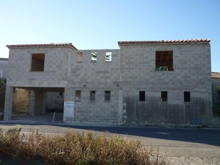 Desportes Rénovation : construction neuve, établissement recevant du public, étude notariale située dans le Gard, murs en agglos, linteaux et chaînage béton.