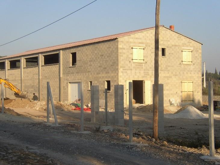 Desportes Rénovation vue extérieure d'un bâtiment industriel à usage mixte de dépôt et de bureaux Hérault